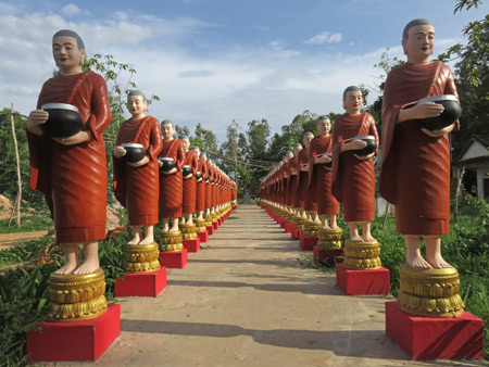 A line of Buddhist monk statues at Wat Bo in Siem Reap, Cambodia.