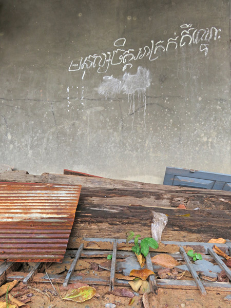 The writing is on the wall at Wat Preah An Kau Saa in Siem Reap, Cambodia.