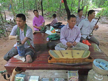 Traditional Cambodian musicians outside Ta Prohm, Angkor in Siem Reap, Cambodia.