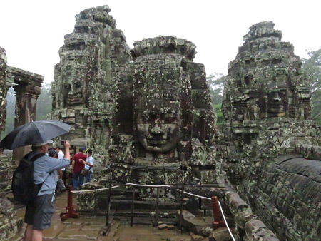 Giant faces wrought in stone at Bayon, Angkor Thom in Siem Reap, Cambodia.