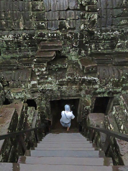 Descending into darkness at Bayon, Angkor Thom in Siem Reap, Cambodia.