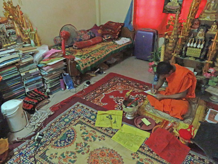 A Buddhist monk in his room in the monastery at Wat Po Lanka in Siem Reap, Cambodia.