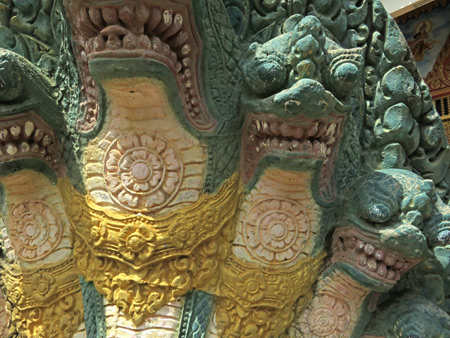 A close-up of the fierce seven-headed dragon guard at Wat Kesaram in Siem Reap, Cambodia.