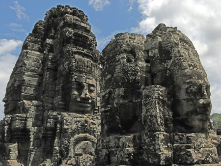 Grinning Buddha faces at Bayon, Angkor in Siem Reap, Cambodia.