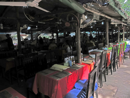 A line of food stalls across the road from the Terrace of the Elephants, Angkor in Siem Reap, Cambodia.