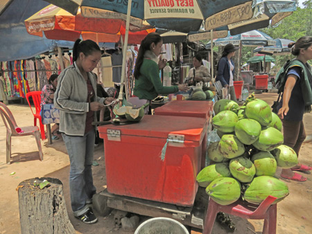 A coconut vendor at Thommanon, Angkor in Siem Reap, Cambodia.