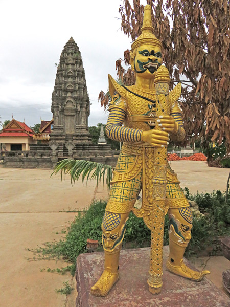 A guard stands watch at Wat Svay in Siem Reap, Cambodia.