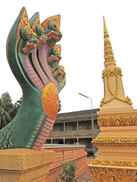 A dragon and a chedi at Wat Svay in Siem Reap, Cambodia.