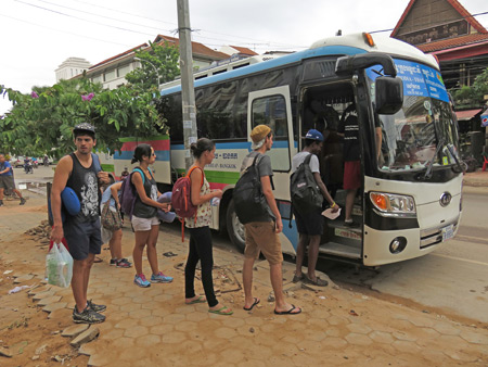 Boarding the Attakan bus from Siem Reap, Cambodia to Bangkok, Thailand.