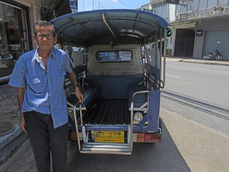 A tuk-tuk driver in Phitsanulok, Thailand.