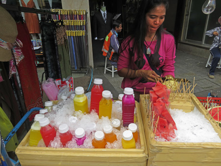 A fruit juice vendor on Thanon Khao San in Banglamphu, Bangkok, Thailand.