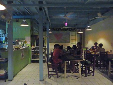 It's dinner time at May Kaidee's in Banglamphu, Bangkok, Thailand.