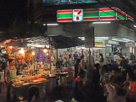 A crowded night market on Thanon Rambuttri in Banglamphu, Bangkok, Thailand.