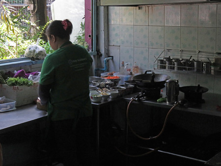 A cook at May Kaidee's in Banglamphu, Bangkok, Thailand.