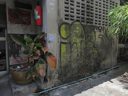 A back lane scene on Thanon Tanao next to May Kaidee's in Banglamphu, Bangkok, Thailand.