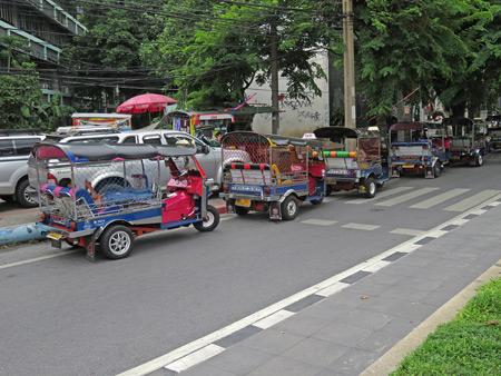A line of tuk-tuks in Bangkok, Thailand.