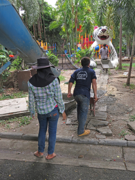 Laborers pour new concrete at the Dusit Zoo in Bangkok, Thailand.