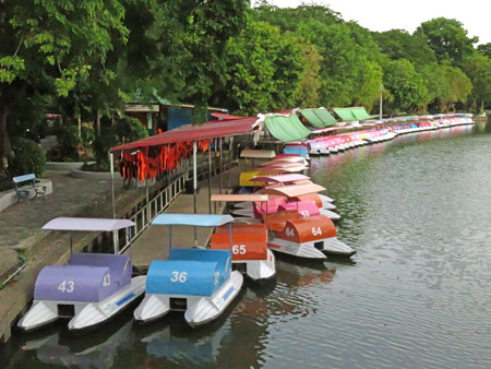 Some brightly colored boats at the Dusit Zoo in Bangkok, Thailand.