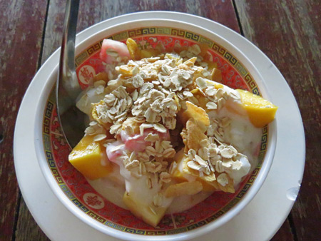 Fruit, yogurt and muesli for breakfast at Number One Vegetarian Restaurant in Banglamphu, Bangkok, Thailand.