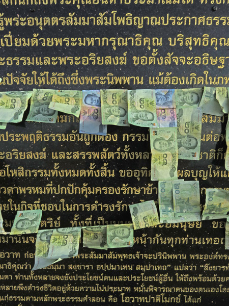 Offerings of 20 baht bills all strung up at the top of the Golden Mount in Bangkok, Thailand.