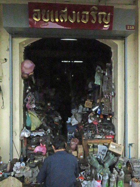 A small, disheveled motor shop in Bangkok, Thailand.