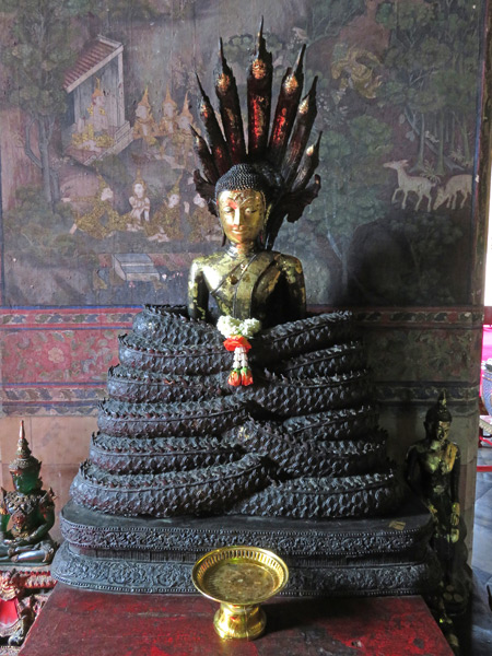 A small Buddha image at Wat Suthat in Bangkok, Thailand.