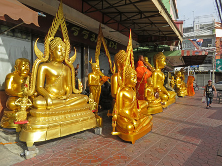A line-up of Buddha images for sale in Bangkok, Thailand.
