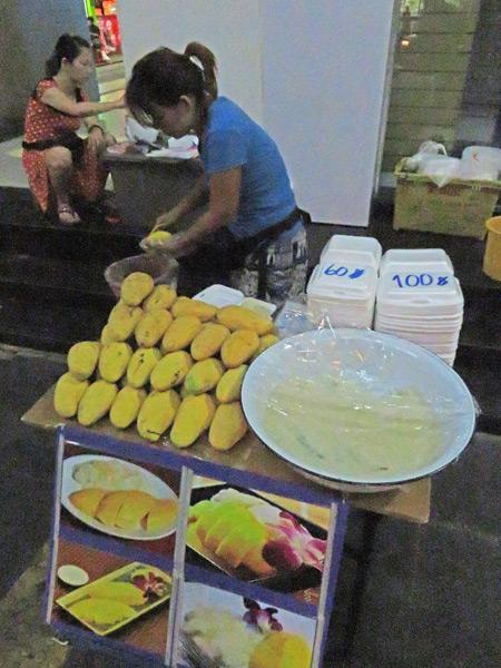 Yummy mango and sticky rice on Thanon Silom in Bangkok, Thailand.