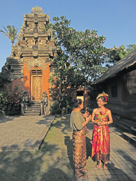 A Balinese beauty gets interviewed in Ubud Palace in Ubud, Bali, Indonesia.