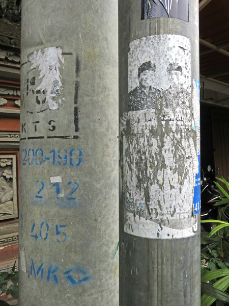 A torn flyer on Jalon Suweta in Ubud, Bali, Indonesia.