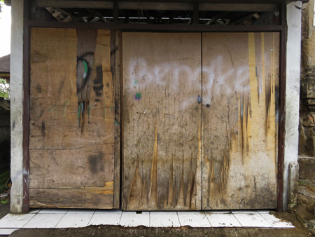 A battered garage door on Jalon Suweta in Ubud, Bali, Indonesia.