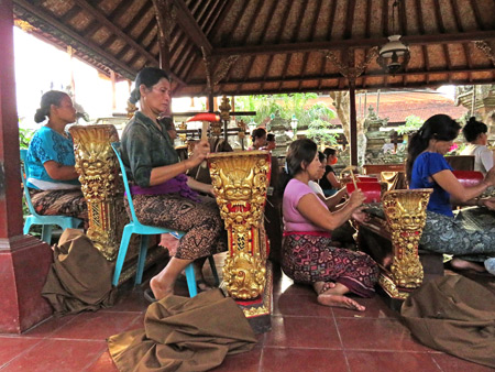 A women's gamelan practices at Ubud Palace in Ubud, Bali, Indonesia.