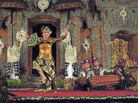 A dancer performs the Teruna Jaya at a Hindu temple ceremony at the bale banjar next door to Pura Desa in Ubud, Bali, Indonesia.