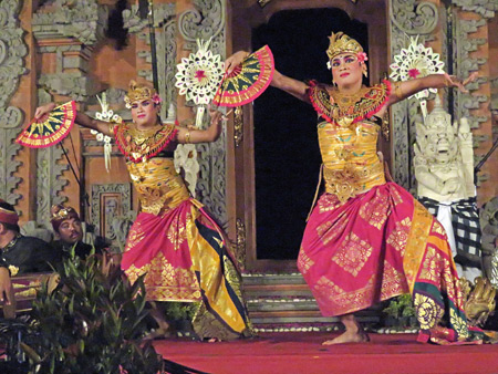 Two dancers perform the Kebyar Duduk at a Hindu temple ceremony at the bale banjar next door to Pura Desa in Ubud, Bali, Indonesia.