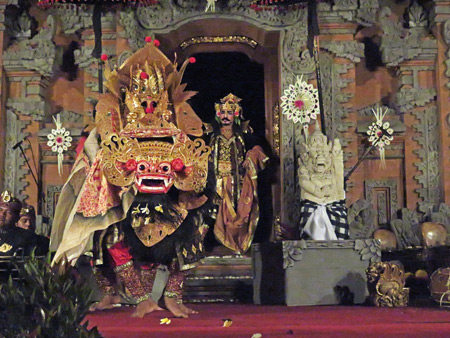 Dancers perform the Barong at a Hindu temple ceremony at the bale banjar next door to Pura Desa in Ubud, Bali, Indonesia.