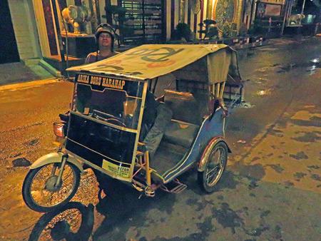 A becak driver on Jalon Gandhi in Medan, Sumatra, Indonesia.