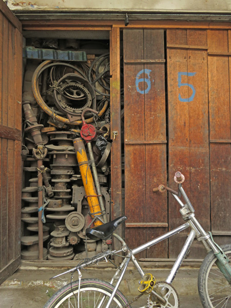 A machine shop and a bicycle in Medan, Sumatra, Indonesia.