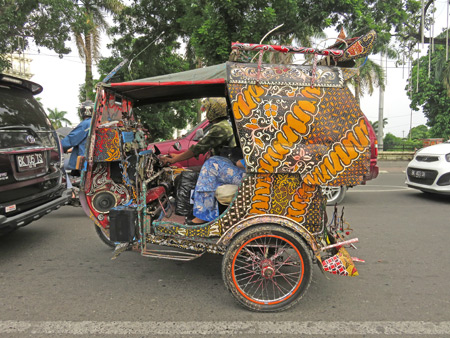 A color-splashed becak in Medan, Sumatra, Indonesia.