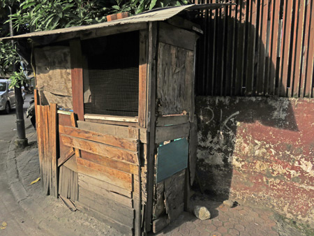 A patched-up shack in Medan, Sumatra, Indonesia.