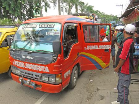 An orange mini-bus from Medan to Bukit Lawang, Sumatra, Indonesia.