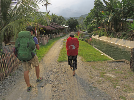 Decker and Joana walking toward Bukit Lawang, Sumatra, Indonesia.