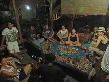 Staff and guests sing songs and make merry at the Lucky Bamboo Guesthouse in Bukit Lawang, Sumatra, Indonesia.