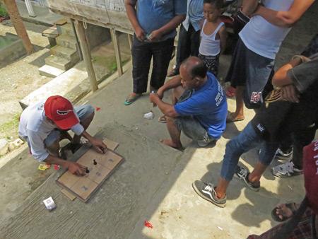 A bit of gambling goes down in Bukit Lawang, Sumatra, Indonesia.