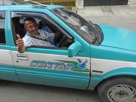 A taxi cab driver in Medan, Sumatra, Indonesia.