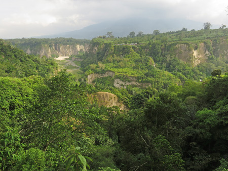 A dramatic overview of Ngarai Sianok from Taman Panorama in Bukittinggi, Sumatra, Indonesia.