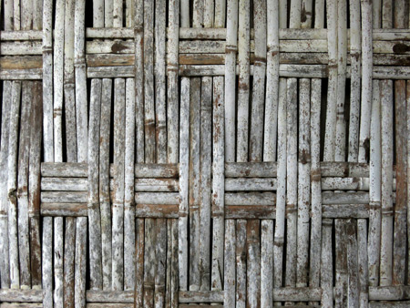 A close-up of a thatched wooden wall on a traditional Minangkabau house in Rao Rao near Bukittinggi, Sumatra, Indonesia.