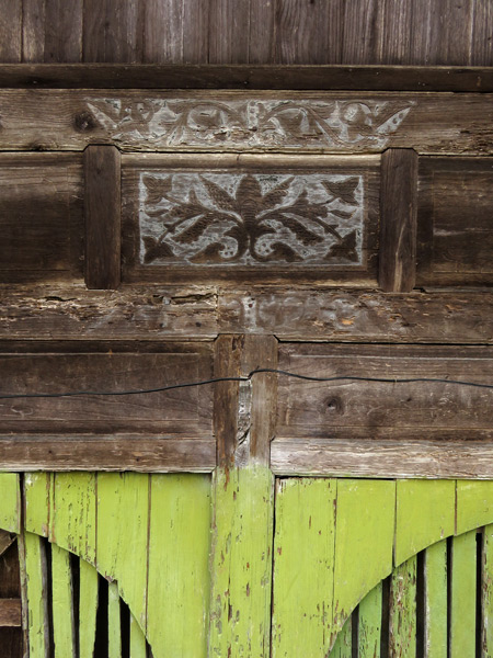 A close-up of a beautiful wooden wall on a traditional Minangkabau house in Rao Rao near Bukittinggi, Sumatra, Indonesia.