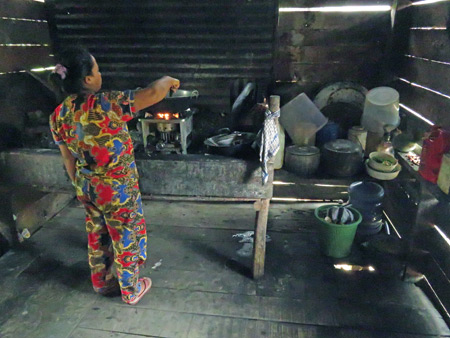 A woman brews up a meal in her kitchen in Rao Rao near Bukittinggi, Sumatra, Indonesia.