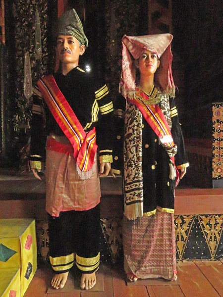 A display of traditional Minangkabau costumes in Pagarayung Palace near Batu Sangkar, Sumatra, Indonesia.
