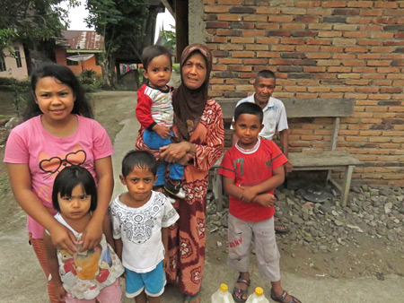 Some locals pose for a photo in a small village near Batu Sangkar, Sumatra, Indonesia.